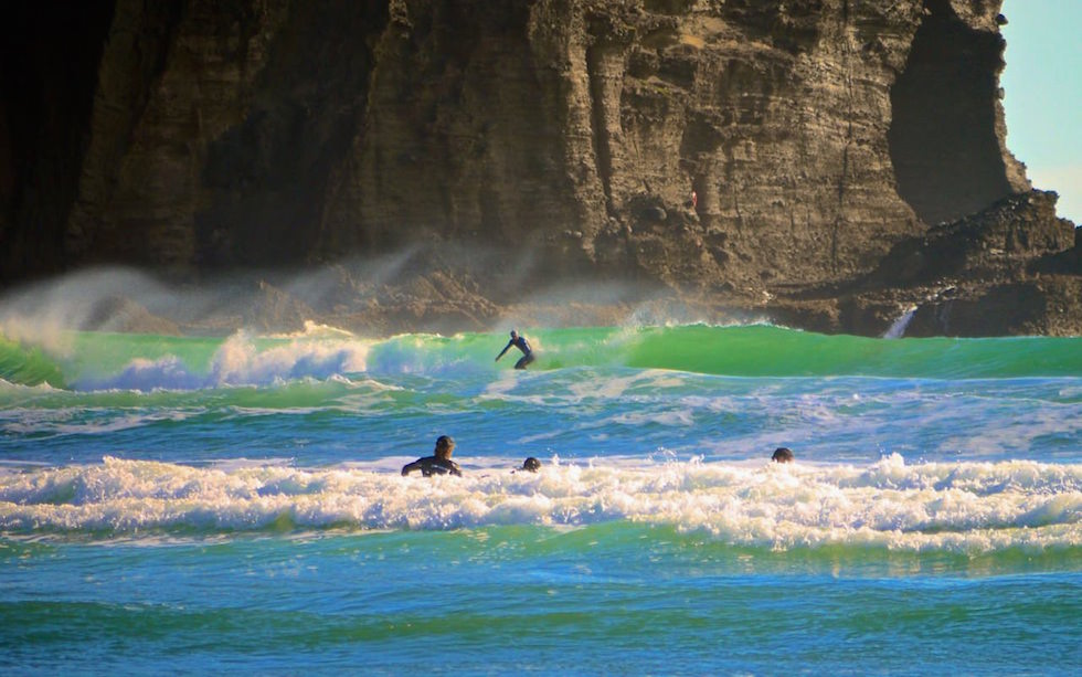 Surfing at the famous beach of Piha near Auckland